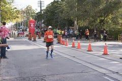 TORONTO, ON/CANADA - OCT 22, 2017: Marathon runner Geoff passing Stock Photography