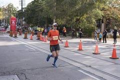 TORONTO, ON/CANADA - OCT 22, 2017: Marathon runner Geoff passing Stock Images