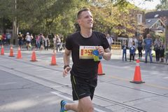 TORONTO, ON/CANADA - OCT 22, 2017: Marathon runner Kyle passing. The 33km turnaround point at the 2017 Scotiabank Toronto Waterfront Marathon Royalty Free Stock Photography