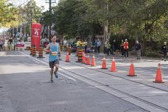 TORONTO, ON/CANADA - OCT 22, 2017: Marathon runner Kyle passing. The 33km turnaround point at the 2017 Scotiabank Toronto Waterfront Marathon Royalty Free Stock Photo