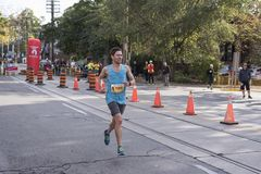 TORONTO, ON/CANADA - OCT 22, 2017: Marathon runner Kyle passing. The 33km turnaround point at the 2017 Scotiabank Toronto Waterfront Marathon Stock Photography