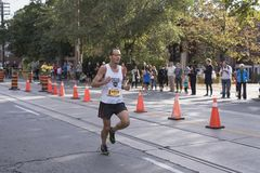 TORONTO, ON/CANADA - OCT 22, 2017: Marathon runner Scot passing Royalty Free Stock Photography