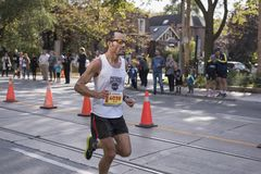 TORONTO, ON/CANADA - OCT 22, 2017: Marathon runner Scot passing. The 33km turnaround point at the 2017 Scotiabank Toronto Waterfront Marathon Stock Photography