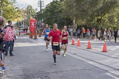 TORONTO, ON/CANADA - OCT 22, 2017: Marathon runners passing the Stock Photos