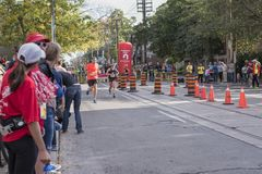 TORONTO, ON/CANADA - OCT 22, 2017: Marathon runners passing the Royalty Free Stock Photography