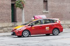 Toyota Prius V Taxi. Toronto, Canada - Oct 14, 2017: Red Toyota Prius V hybrid MPV used as a taxi in the city of Toronto Stock Photo