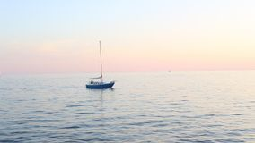 Toronto, ON, Canada - September 23, 2017 - short video of sunset on Lake Ontario with sailboat speedboats and jetskies stock video footage