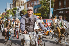 Toronto, Canada - September 20, 2014: Tweed Ride. Toronto, Canada - September 20, 2014: Unidentified participants of Tweed Ride Toronto riding on their bicycles royalty free stock image