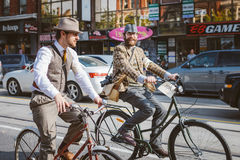 Toronto, Canada - September 20, 2014: Tweed Ride. Toronto, Canada - September 20, 2014: Unidentified participants of Tweed Ride Toronto riding on their bicycles stock image