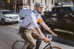 Toronto, Canada - September 20, 2014: Tweed Ride. Toronto, Canada - September 20, 2014: Unidentified participants of Tweed Ride Toronto in vintage style clothes stock photography