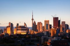 Toronto city center skyline during early morning golden hour sunrise. Toronto city center aerial view of skyline during early morning golden hour sunrise royalty free stock images