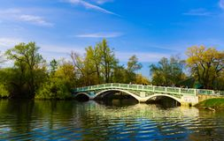 Beautiful inviting view of old vintage retro style bridge at Toronto center island with people walking Royalty Free Stock Image