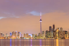 Toronto city dusk over lake with colorful light Royalty Free Stock Image