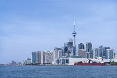 Toronto city skyline with urban skyscrapers in front of Lake Ontario on a sunny day Stock Image