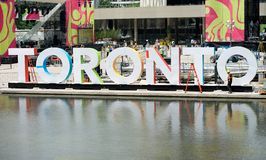 Toronto city square with the letters TORONTO and reflection on a fountain in July 7, 2015. Toronto, Canada - July 7: Toronto city square with the letters Royalty Free Stock Photo