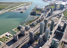Toronto cityscape. Panorama of downtown high rise condominiums and a yacht marina along the Lakeshore with part of the Island airport showing in Toronto, Ontario Royalty Free Stock Photos