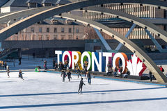 Toronto 3D Sign Nathan Phillips Square, Canada. Winter Lifestyle. Iconic Toronto 3D sign in Nathan Phillips Square and the multicultural city everyday lifestyle Stock Photo