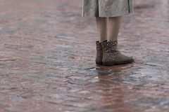 Toronto Distillery District, woman with autumn boots on a rainy day Royalty Free Stock Image