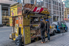 Toronto food trucks. Mobile Food Truck seen daily on street in Toronto Ontario Stock Image