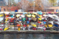 Toronto Harborfront circa late fall 2015: Colorful kayaks stored Stock Photo