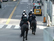 TORONTO - JUNE 23, 2010 - Police officers marching on the streets on horses during G20 Protest in Toronto, Ontario, Canada. Stock Image