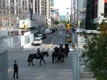 TORONTO - JUNE 23, 2010 - Police officers marching on the streets on horses during G20 Protest in Toronto, Ontario, Canada. Royalty Free Stock Images