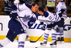 Toronto Mapleleafs Captain Dion Phaneuf. Leafs Captain Dion Phaneuf takes a slapshot on goalie Jonas Gustavsson during Thursdays pre-game skate at the TD Garden Royalty Free Stock Photography