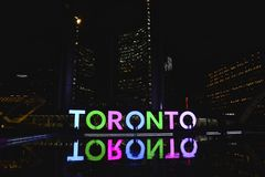 Toronto. Multicolored light sign at night at Nathan's Philip Square in downtown royalty free stock photo