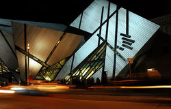 Toronto museum at night. This shows the modern addition to the Royal Ontario Museum, illuminated at night.  Designed by noted architect Daniel Libeskind Stock Images