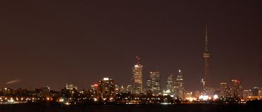Toronto at night. Midnight view on Toronto from coast of Ontario lake Stock Photo