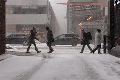 People on Street Snow Storm Canada Toronto Feb 12 2019 royalty free stock image