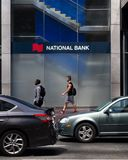 Toronto, Ontario/Canada - July 20 2018: National Bank Head Office Toronto People Walking By Sign Signage Logo Sidew royalty free stock photos
