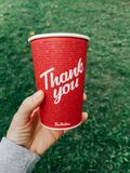 Toronto, Ontario, Canada - September 12, 2020: Thank you phrase on coffee cup from Canadian Tim Hortons restaurant chain. Thanks