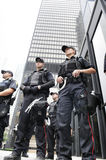 Toronto police officers guarding a building. Royalty Free Stock Images