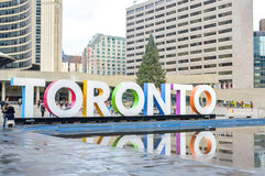 Toronto sign and Nathan Phillips Square in Toronto. Toronto, Canada - November 16, 2016: Toronto sign and Nathan Phillips Square in Toronto, Canada. People can Royalty Free Stock Images