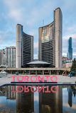Toronto sign and the New City Hall on Nathan Phillips Square - Toronto, Canada royalty free stock photo