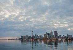 Toronto skyline. At sunset with water reflection stock images