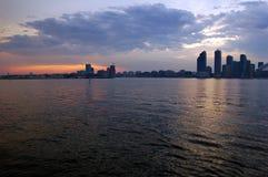 Toronto skyline. From Ontario lake in time of sunset Stock Photos