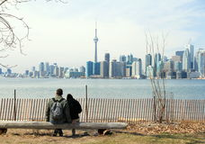 Toronto Skyline and Couple on a Bench Royalty Free Stock Photo