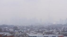Toronto skyline covered by dense fog. Video of Toronto skyline covered by dense fog stock footage