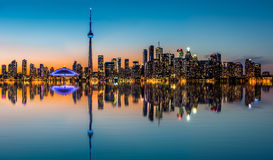 Toronto skyline at dusk. Reflected in the Inner Harbor Bay stock images