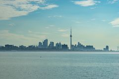 Toronto Skyline with mist floating on the sea stock photography