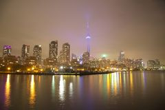 Toronto Skyline at night with a reflection in Lake Ontario Royalty Free Stock Images