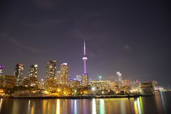 Toronto Skyline at night with a reflection in Lake Ontario Royalty Free Stock Image