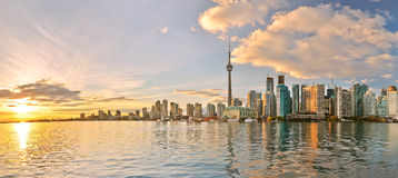 Toronto skyline at sunset in Ontario, Canada. Panorama of Toronto skyline at sunset in Ontario, Canada royalty free stock photography