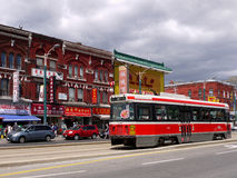 Toronto Streetcar in Chinatown. Toronto's colorful old Chinatown on Spadina Avenue is a shopping area that is popular with people of all ethnic backgrounds Stock Image