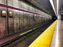 Toronto subway station. An empty station tunnel and platform in the Toronto transit system Stock Photos