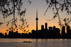 Toronto Sunset Silhouette with  canoeists in the water Royalty Free Stock Photos