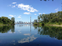 Toronto from Toronto Island. The CN Tower and Toronto city skyline are nearly perfectly reflected in the still waters of Toronto Island in Lake Ontario Stock Photo