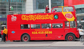 Toronto Tour Bus Hop on hop off. Double Decker city sightseeing red tour bus, parking on Dundas Square,toronto canada Royalty Free Stock Image